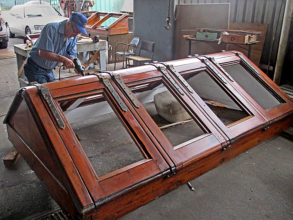 George reattaching bronze hinges - John Oxley engine room skylights in teak