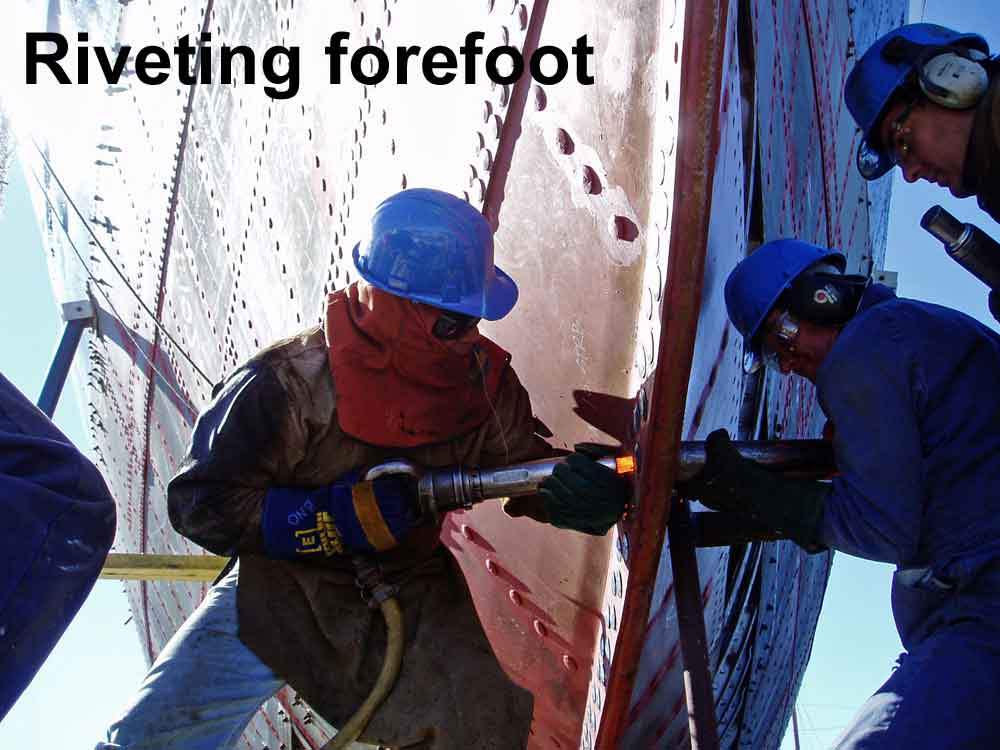 """Driving 1"""" rivets into the forefoot, using two rivet guns"""