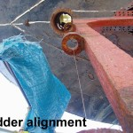 Wire stretched tight to verify rudder post alignment