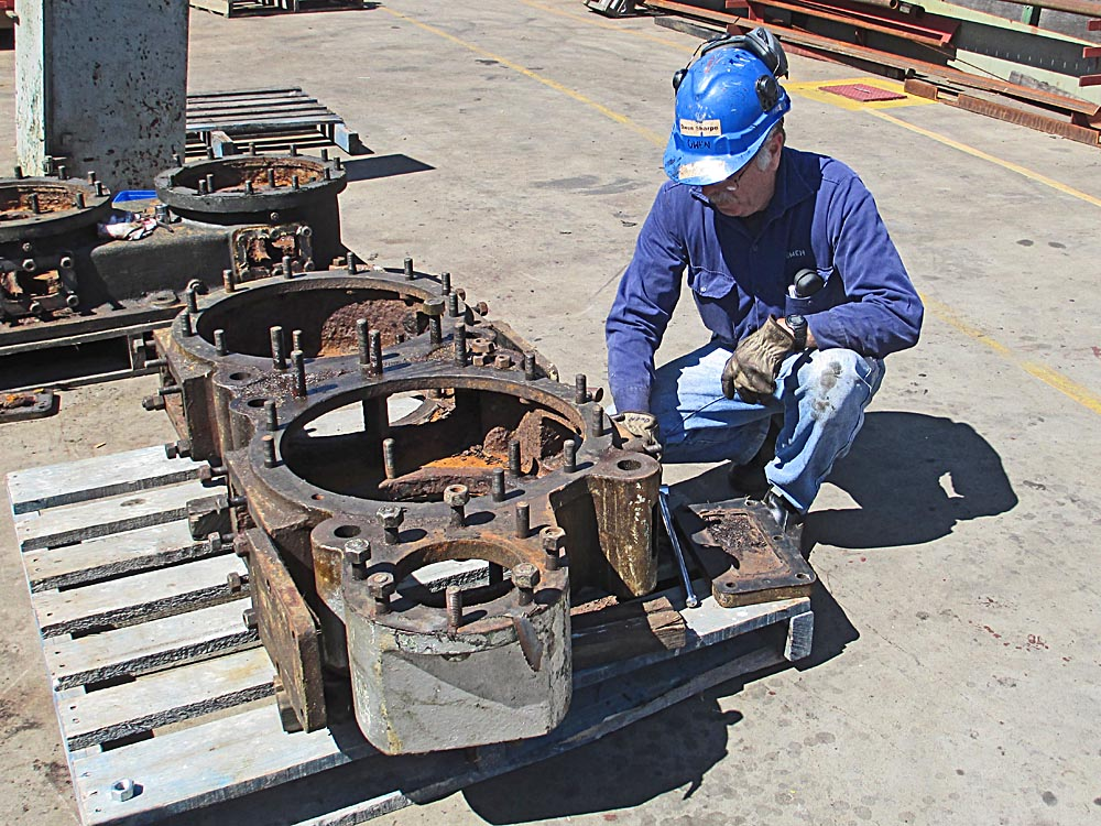 Owen-inspecting-dismantled-air-pump-base-ashore