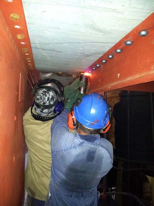 Holding up hot rivets - steel deck above engine room