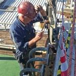 Ian drilling out bridge deck rivets.