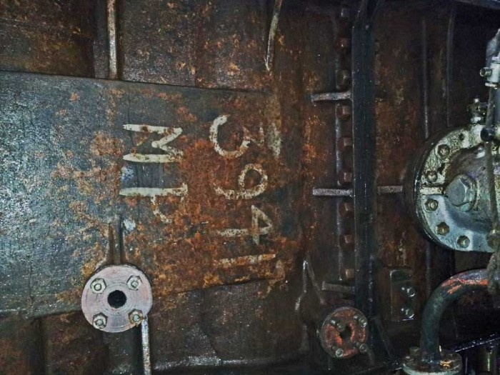 Main engine cylinders under removed cleading showing whitewash labels.