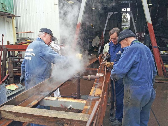 New main deck beams being shaped by torch and water