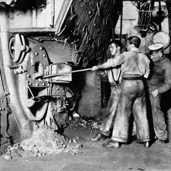 Photograph of firemen working in the stokehold of a British ship 1913.