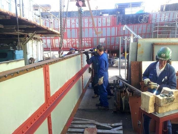 Team riveting forward part bridge deck