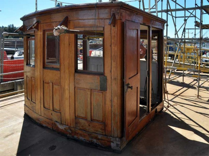Wheelhouse removed to dock for restoration.